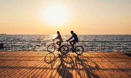couple-on-bikes-at-boardwalk-sunset