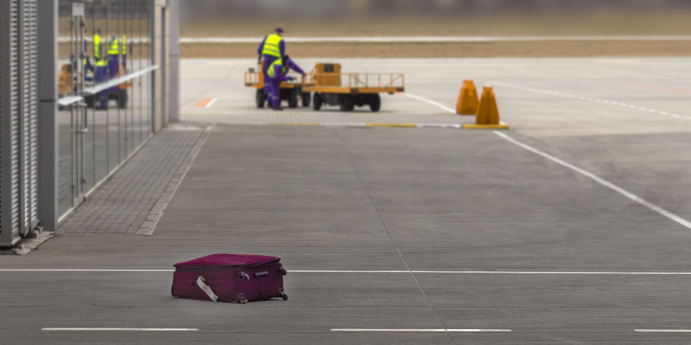Luggage lost on airport tarmac.