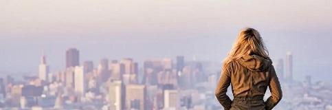 Woman overlooking city.