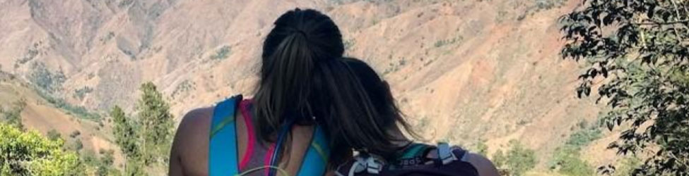young-women-looking-out-over-mountain