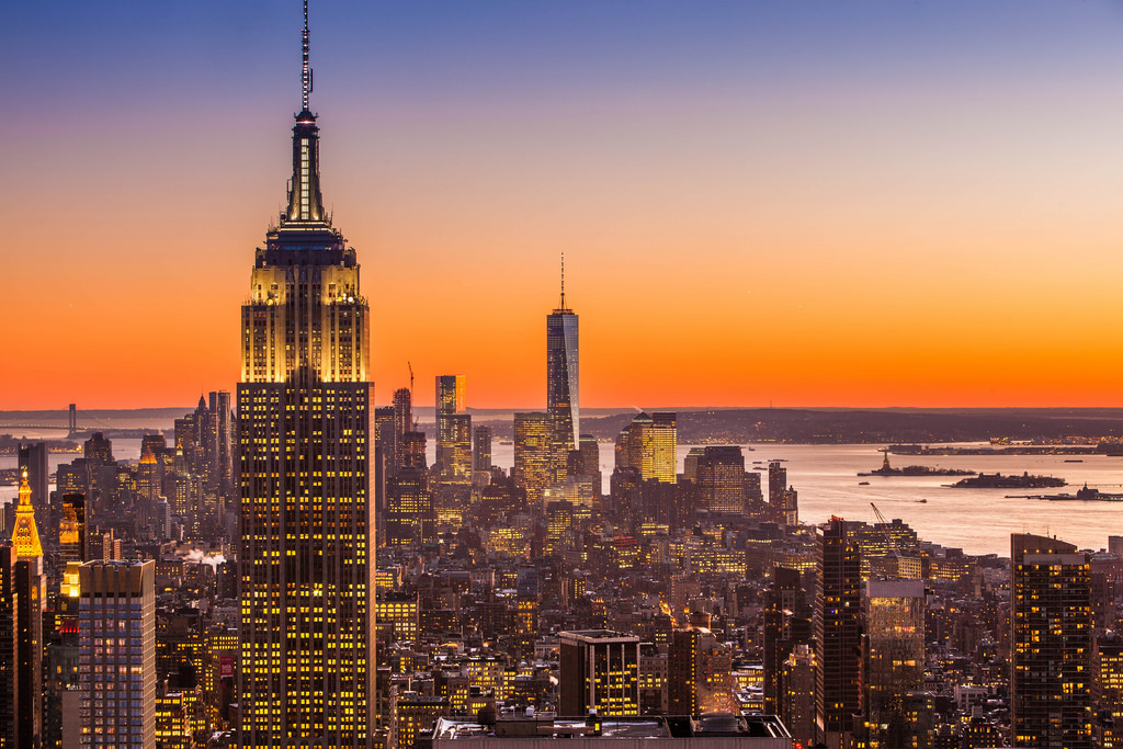 Empire state building and New York skyline at sunset