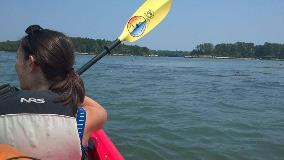 girl-in-a- kayak-on-a-lake-holding-an-oar