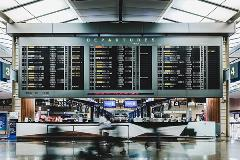 airport-departure-and-arrival-signs-in-terminal-trip-insurance