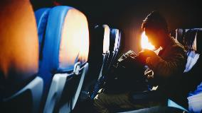 Man-sitting-on-plane