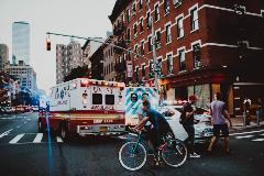 ambulance-on-city-street-Liaison-Travel-Series