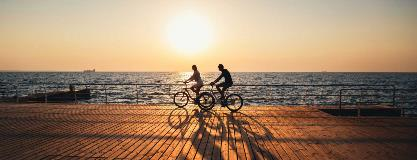 A-couple-with-travel-insurance-rides-bikes
