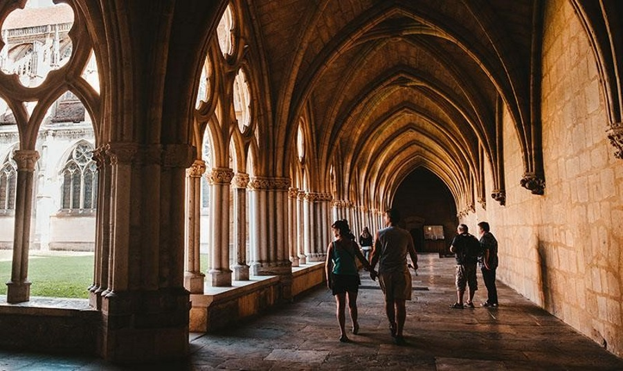 People-exploring-a-castle-hall