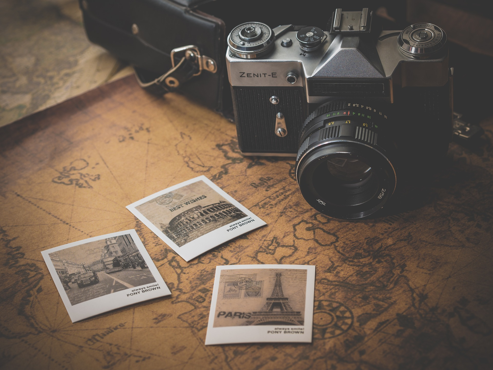 camera-and-pictures-on-old-map-CFAR-and-trip-insurance