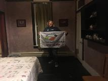 Amanda-poses-with-the-Seven-Corners-flag-in-haunted-hotel