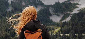 A-female-traveler-is-happy-she-bought-trip-insurance
