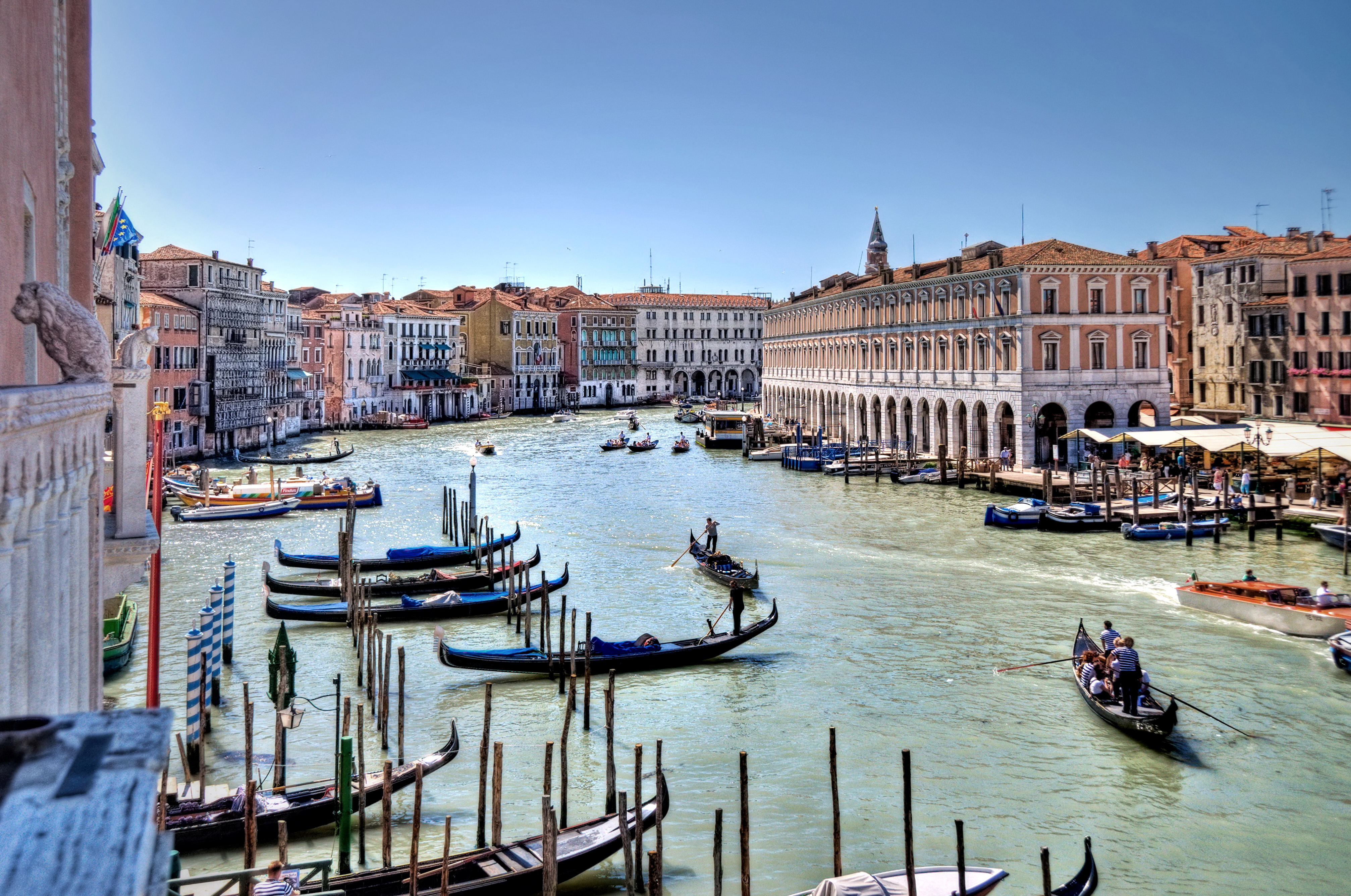 Grand canal with gondolas in Italy