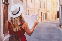 woman with travel insurance wanders streets with map