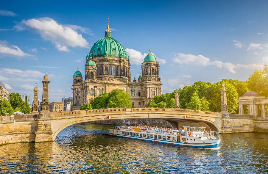 A-ship-cruises-down-a-river-in-Europe