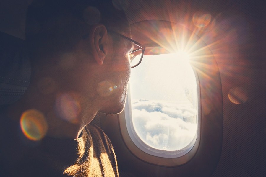 A-person-with-trip-insurance-travels-on-a-plane