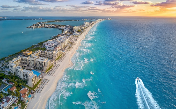 A-stretch-of-beach-inhabited-by-people-with-trip-insurance