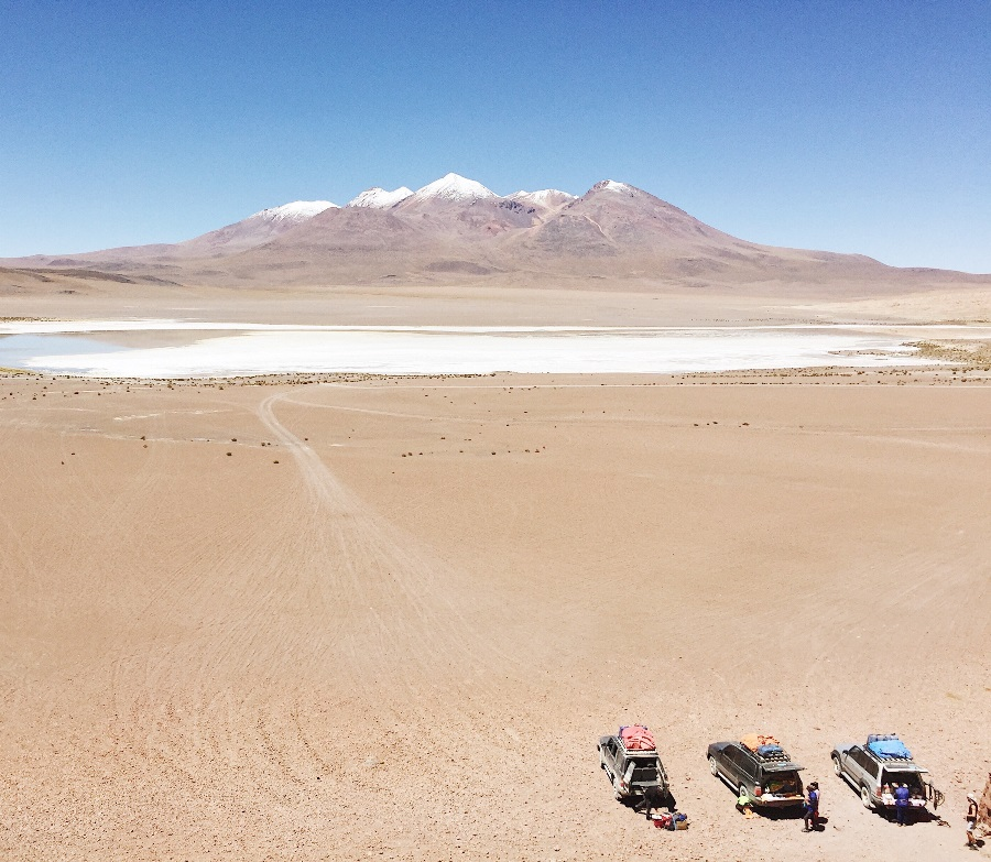 Overhead-shot-of-jeeps-parked-in-the-desert