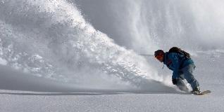 A-snowboarder-shredding-down-a-mountain