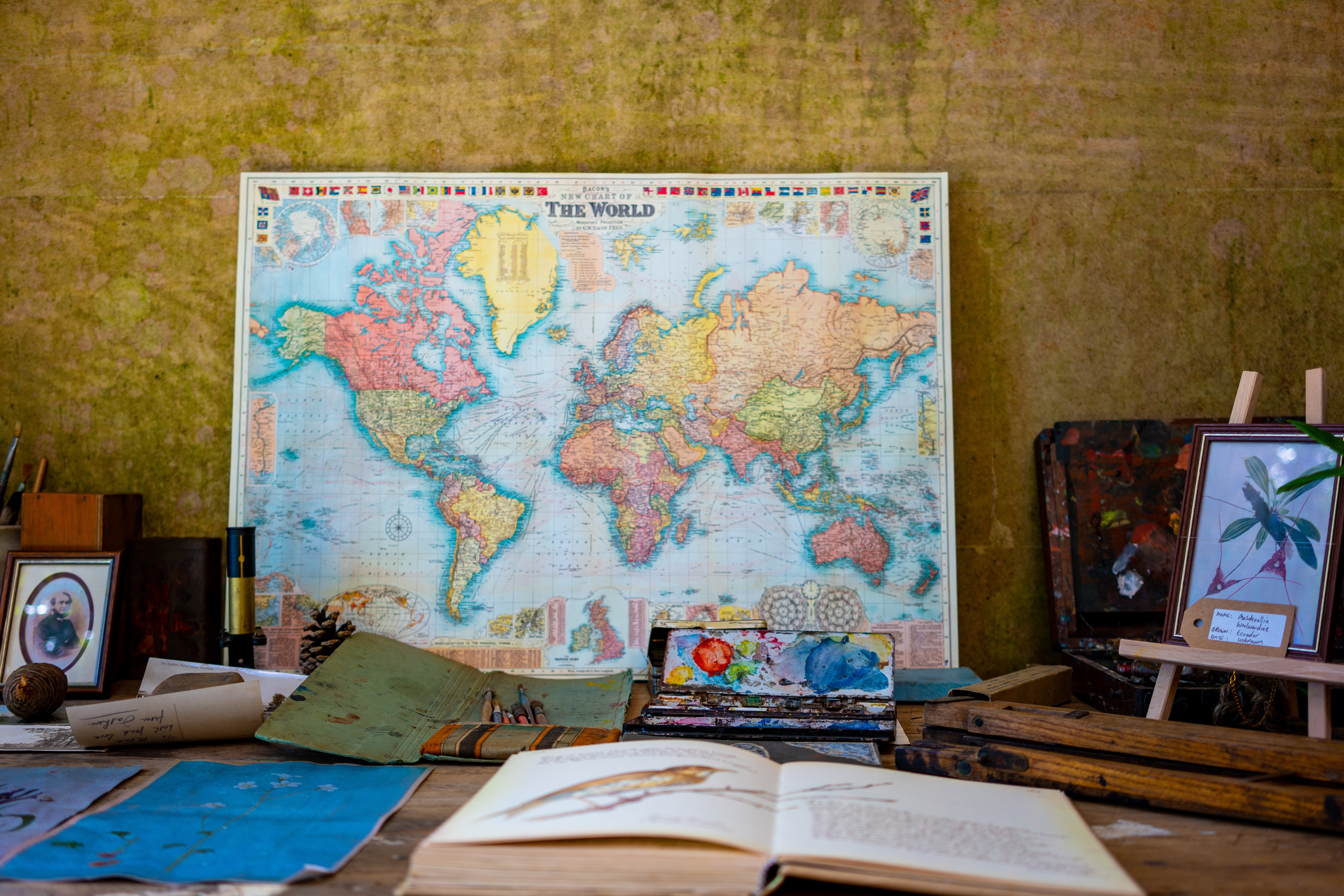 world-map-near-book-and-easel
