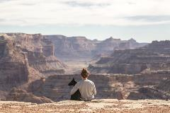 Dog-and-owner-sitting-on-edge-of-Grand-Canyon