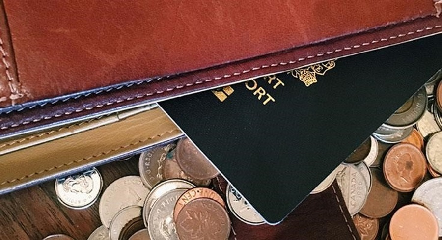 Passport-laying-on-pile-of-coins