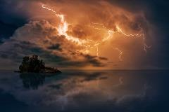 stormy-sky-over-ocean-with-island