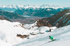 Skier-Skiing-Down-Mountainous-Slope