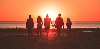 Group-on-beach-during-sunset