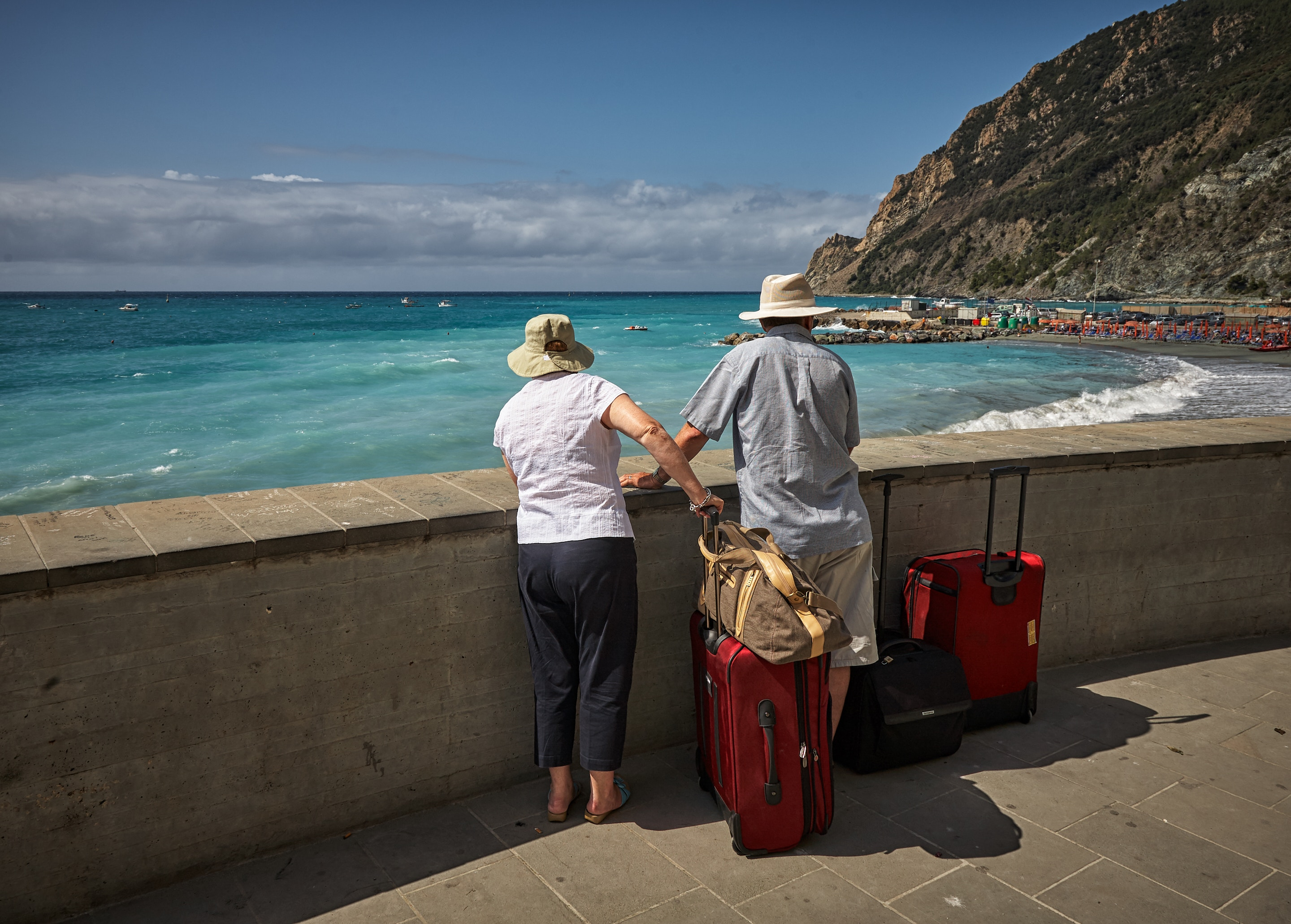 older-couple-looking-over-seawall