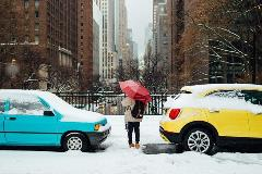 Woman-stands-between-cars-in-the-winter