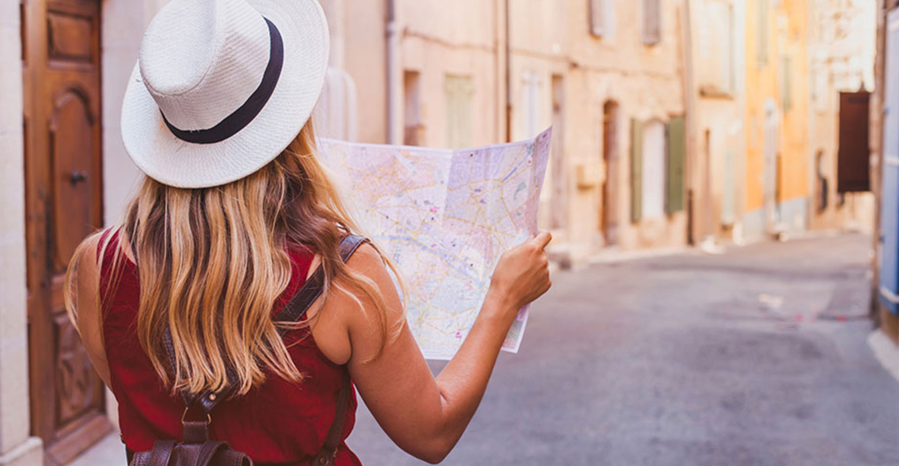 Young woman reading a map in Europe.